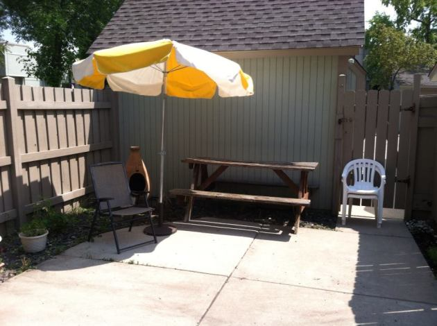 Chair, umbrella and my chimnea behind it. I love lighting fires in the cooler weather.